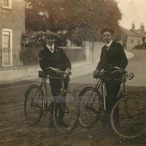 Two Dapper Cyclists Near Unknown Bridge, c. 1920s